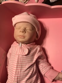 Baby doll with lifelike head arms and legs 17 mi