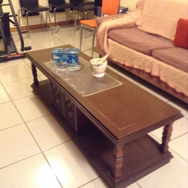 Solid wood coffee table. Great for games storage.