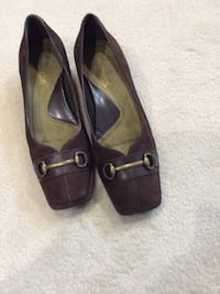 Pair of brown aerosol leather slip-on shoes. size 7