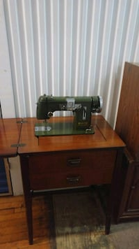 Very old well kept sewing machine