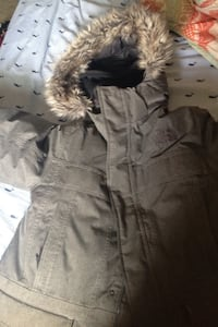 black and brown The North Face parka Perry