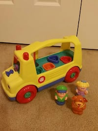 yellow and red plastic toy truck
