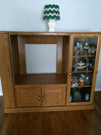 brown wooden TV hutch with flat screen television Brampton, L6S 3X4