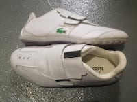 Pair of white lacoste low-top sneakers size 9.5