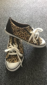 brown-and-white Coach leopard print sneakers Worcester
