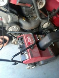red and black Honda pressure washer 86 mi