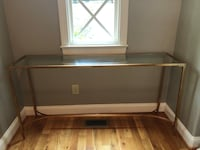 Glass and gold console table  Raleigh, 27609