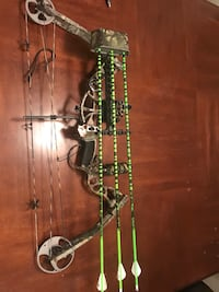 beige and gray compound bow with arrows