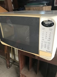 white and beige Sharp microwave oven