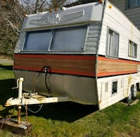 white and red RV trailer Terrace