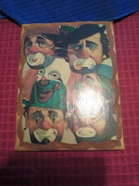 Wood plaque be with pictures of Emmett Kelly