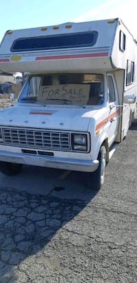 white Ford recreational vehicle 3006 km