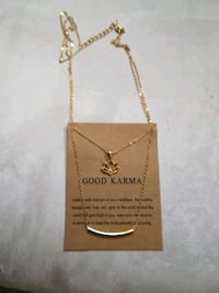 gold-colored necklace with pendant Oshawa, L1H 1B4