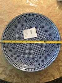 Different sizes plates for sale and the price on them Reston