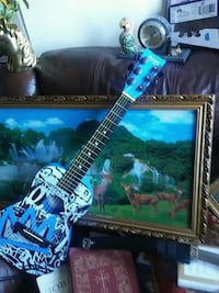 black and blue electric guitar Miami, 33126