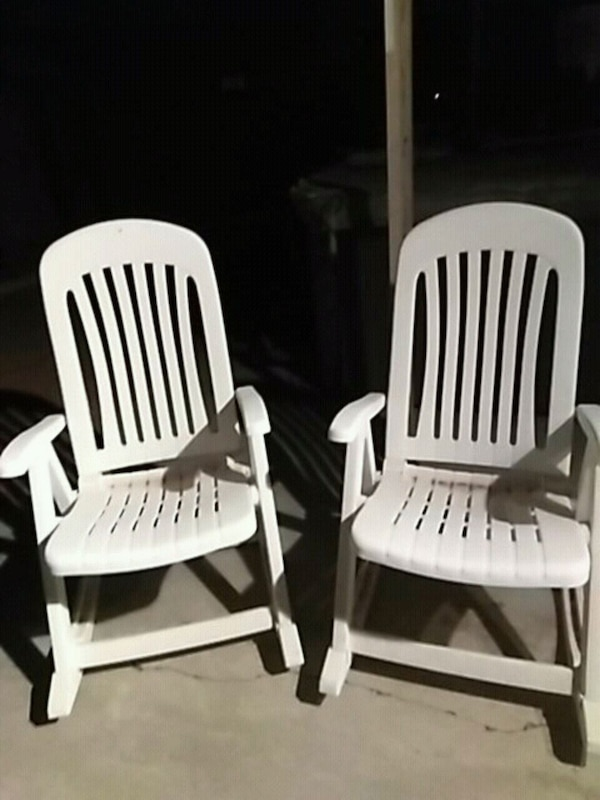 two white wooden windsor chairs