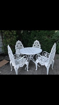 round white metal table with four chairs patio set Toronto, M6C 2M2
