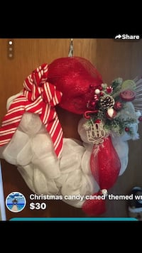 Red and white wreath with text overlay Bay Shore, 11706