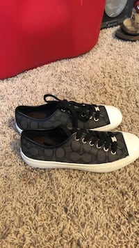 pair of black-and-white Coach sneakers Hendersonville, 37075
