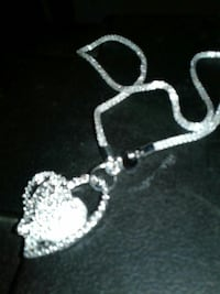 Stamped 925 sterling silver with a solid heart loc