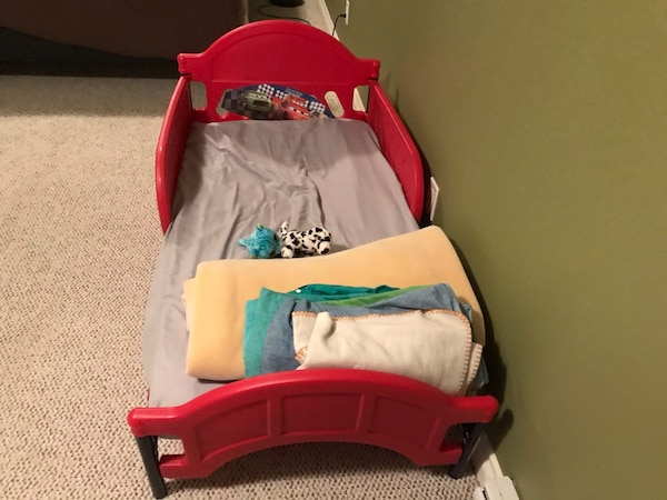 Toddler's red and white bed frame