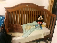 baby's brown wooden crib North Lauderdale, 33068