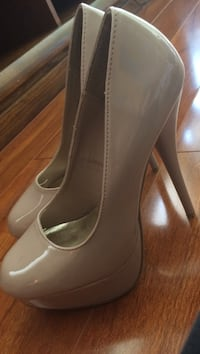 Pair of brown patent leather stilettos Reston