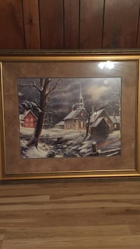 Gray house painting with brown wooden frame