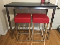 High top table with red stools