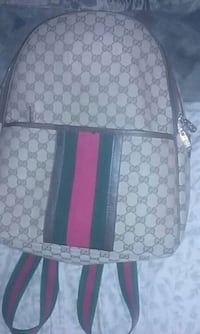 gray and black Gucci backpack Thibodaux, 70301