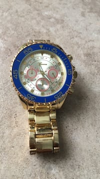 round gold Rolex chronograph watch with link bracelet