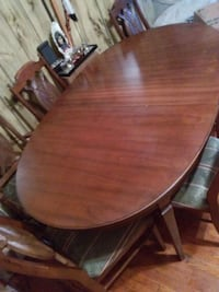 oval brown wooden dining table with chairs Philadelphia, 19130