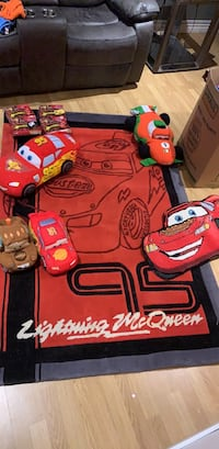 Cars lot carpet toys stuffed toys play cars and a box of pillows sheets and blanket sets  Hamilton