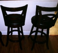 two black wooden bar stools STOCKRTWN Township, 18040