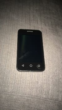 Black Alcatel smart phone with charger Croydon, CR0