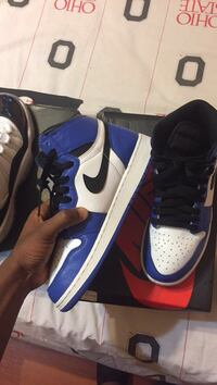 pair of blue-and-white Nike basketball shoes St. Louis, 63116