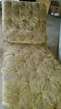 brown and green floral fabric sofa chair
