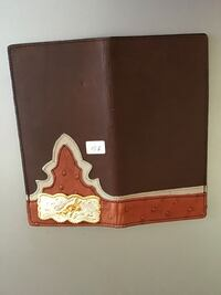 brown and white leather wallet Ventura, 93001
