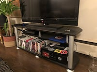black flat screen TV with black wooden TV stand Vancouver, V5N 4E8