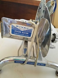 ON HOLD..Meat or cheese electric slicer 1197 mi