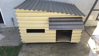 white and black wooden pet house