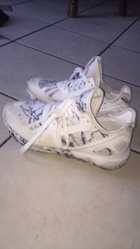 Pair of white-and-gray adidas running shoes