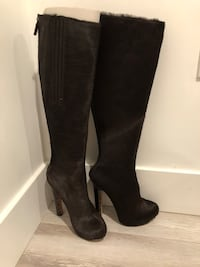 pair of black leather knee-high boots Los Angeles, 90015