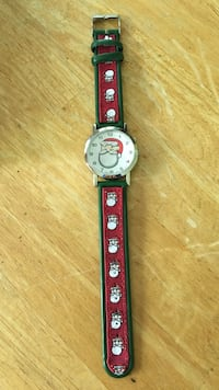 Round silver analog Santa watch with red and black strap  Darien, 06820