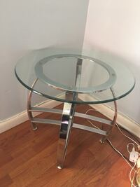 round clear glass-top table with gray steel base Hialeah, 33013