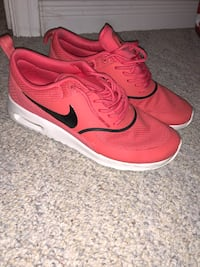 pair of red Nike low-top sneakers London, N6E 1Z1