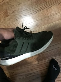 green Adidas Ultra Boost low-top sneakers