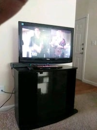 black flat screen TV with black wooden TV stand Houston, 77009