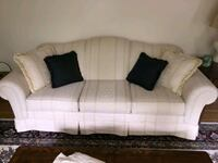white upholstered sofa, and love seat with tables