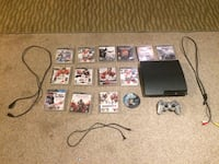 Black sony ps3 slim console with games controller and cords